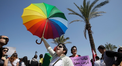 Lebanese activists chant slogans during a demonstration in front of parliament in Beirut